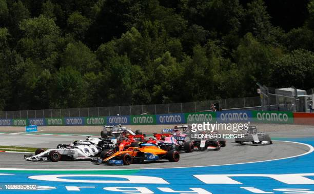This picture taken on July 12, 2020 in Spielberg, Austria shows a collision between Ferrari's German driver Sebastian Vettel and Ferrari's Monegasque...