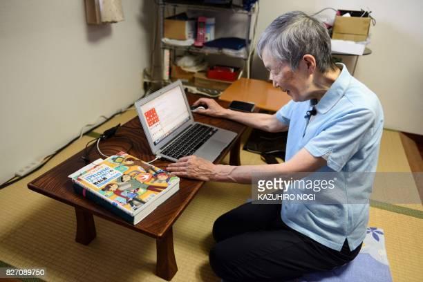 This picture taken on July 13 2017 shows 82yearold programmer Masako Wakamiya using her laptop in her home in Fujisawa Kanagawa prefecture When...