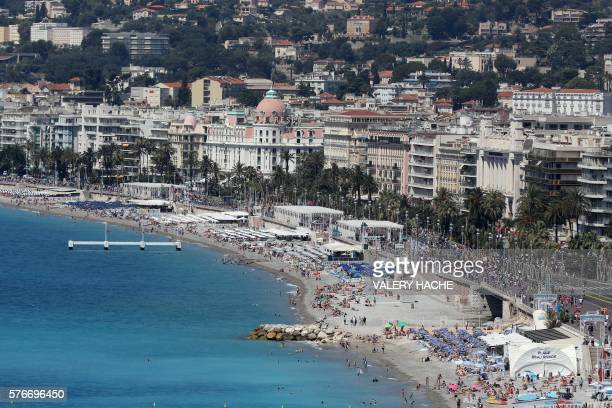 This picture taken on July 17 shows a general view of the beach and the Promenade des Anglais in the French riviera city of Nice three days after...
