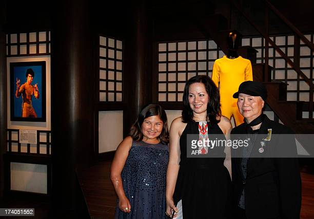 This picture taken on July 19 2013 shows Shannon Lee daughter of the late kung fu legend Bruce Lee posing with her 10yearold daughter Wren and Phoebe...