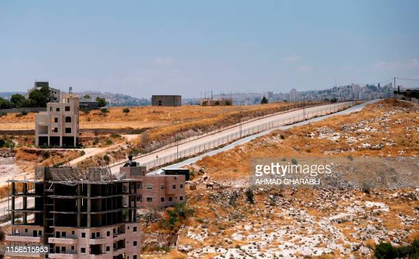 This picture taken on July 19 2019 shows Palestinian buildings still under construction which have been issued notices to be demolished in the Wadi...