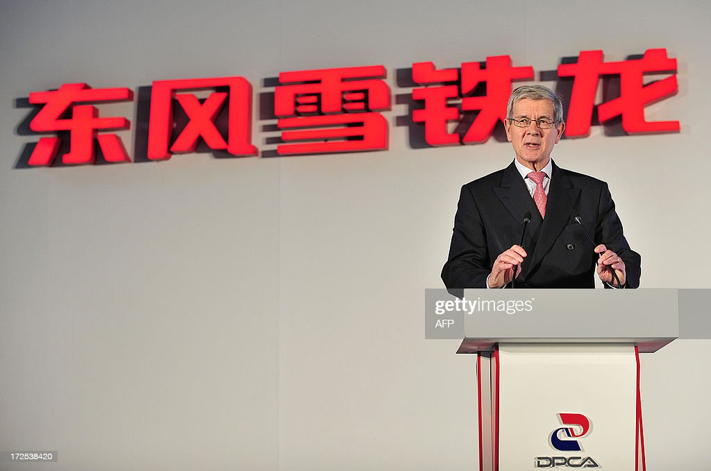 This picture taken on July 2, 2013 shows Philippe Varin, CEO of PSA Peugeot Citroen, giving a speech in a new plant of Dongfeng Peugeot-Citroën Automobile Limited (DPCA) in Wuhan, central China's Hubei province. China's second biggest automaker, Dongfeng, has held talks about buying a stake in troubled French car firm PSA Peugeot Citroen, a state-backed newspaper said on July 3. CHINA