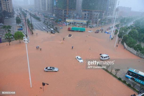 TOPSHOT This picture taken on July 2 2017 shows an aerial view of a flooded street in Changsha Hunan province Days of torrential rain in Hunan...