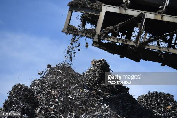 This picture taken on July 2, 2019 in Guyot Environnement recycling company shows a screening machine sorting metallic waste, in Brest, western...