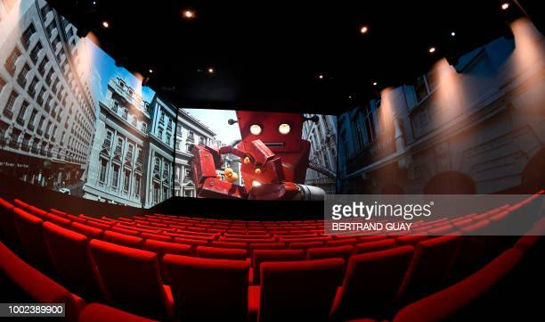 This picture taken on July 20 2018 shows a cinema room with Screen X projector at Pathe cinema in Parc de La Villette in Paris
