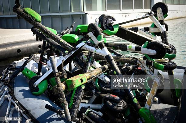 This picture taken on July 20 2019 shows a pile of rescued escooters after their recovery from the seawater along the Marseille's coast southeastern...
