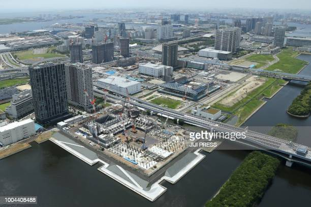 This picture taken on July 21 2018 shows an aerial view of the Ariake Arena and the Olympic Gymnastic Centre under construction in Tokyo for the...