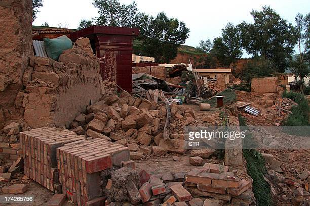 This picture taken on July 22 2013 shows a damaged building in the earthquakehit township of Majiagou in Minxian county in Dingxi in northwest...