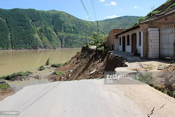 This picture taken on July 22 2013 shows a damaged road after a pair of shallow earthquakes hit the area in Dingxi in northwest China's Gansu...