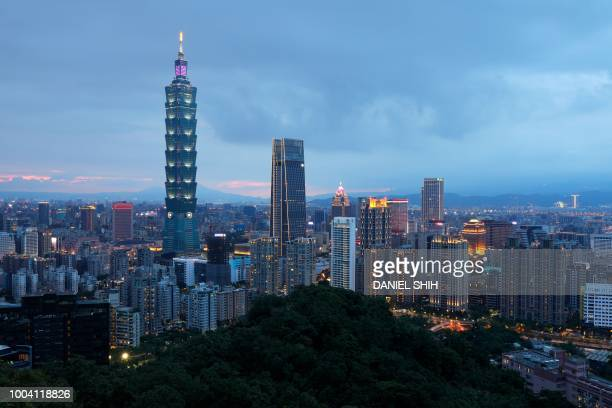 This picture taken on July 22 2018 shows a night view of the Xinyi Shopping District including the Taipei 101 building in Taipei