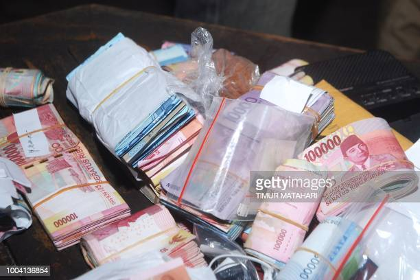 This picture taken on July 22 2018 shows Indonesian bank notes seized from inmates at the Sukamiskin jail in Bandung Inmates at an Indonesian prison...