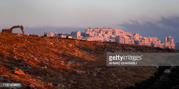 This picture taken on July 22 2019 from the Palestinian village of Sur Baher in East Jerusalem shows a view of the Israeli settlement of Har Homa in...