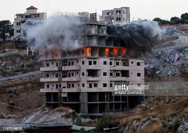 TOPSHOT This picture taken on July 22 shows the demolition of a Palestinian building which was under construction in the the Palestinian village of...