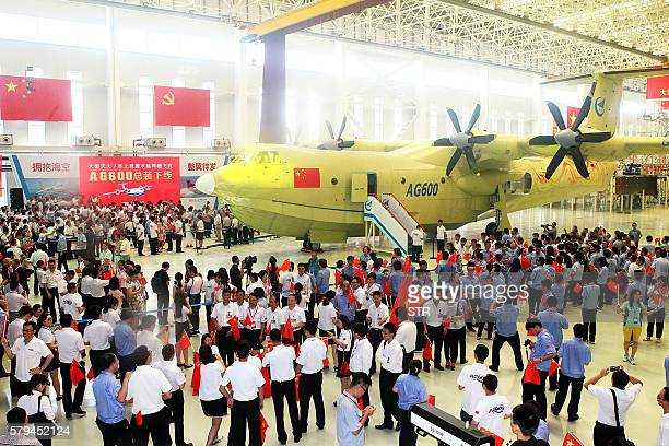 This picture taken on July 23 2016 shows a crowd at a ceremony to unveil the AG600 amphibious plane in Zhuhai in south China's Guangdong Province...