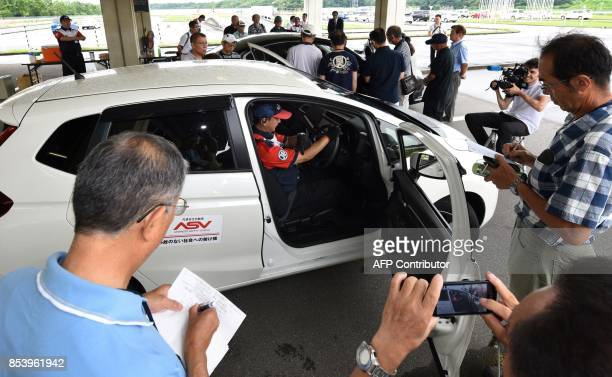 This picture taken on July 23 2017 shows an instructor giving lessons on car maintenance at a driving school for senior citizens managed by the Japan...