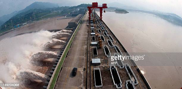 This picture taken on July 24, 2012 shows water released from the Three Gorges Dam, a gigantic hydropower project on the Yangtze river, in Yichang,...