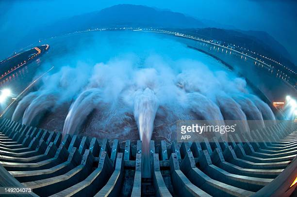 This picture taken on July 24 2012 shows water released from the Three Gorges Dam a gigantic hydropower project on the Yangtze river in Yichang...