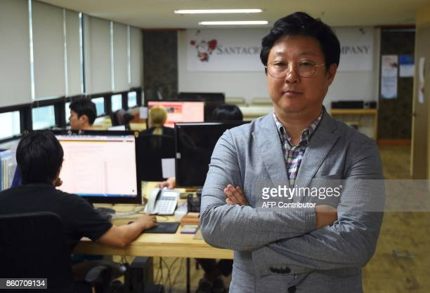 This picture taken on July 24 2017 shows Kim HoJin CEO of Santa Cruise 'digital laundry' company posing at his office in Seoul The company is tasked...