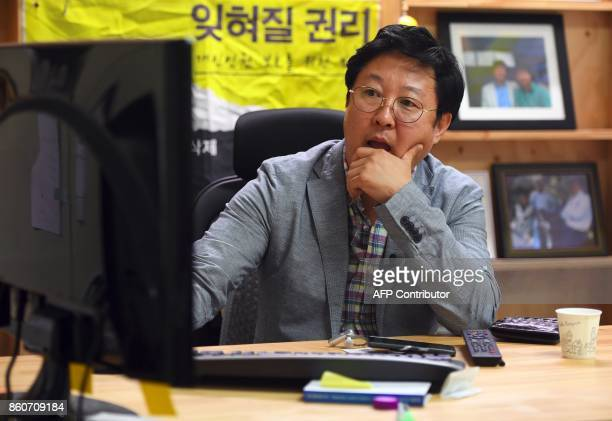This picture taken on July 24 2017 shows Kim HoJin CEO of Santa Cruise 'digital laundry' company checking a computer screen for 'revenge porn' at his...