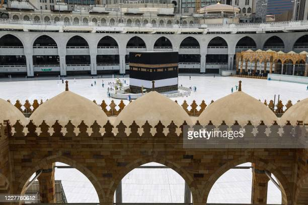 This picture taken on July 24, 2020 ahead of the annual Hajj pilgrimage season in Saudi Arabia's holy city of Mecca shows a view of the Kaaba,...