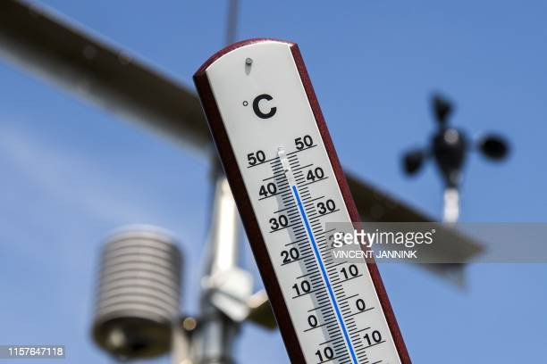 This picture taken on July 25, 2019 shows a thermometer indicating a temperature of over 40 degrees at a Royal Netherlands Meteorological Institute...