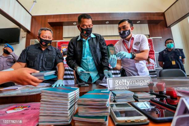 This picture taken on July 25, 2020 shows police displaying evidence as suspects , allegedly linked to the death of an Indonesian sailor aboard a...