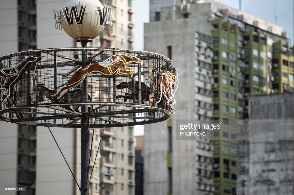 This picture taken on July 26, 2018 shows a neon sign at the shut down Canidrome Club in Macau, which was Asia's only legal dog-racing track. - First opened in 1931, the track's closure on July 21, 2018 was a victory for those who had spent years criticising its treatment of the animals. (Photo by Philip FONG / AFP) / TO GO WITH Macau-sport-animal-greyhounds,Focus by Laura MANNERING