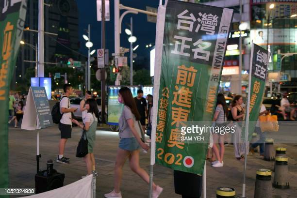 This picture taken on July 26 2018 shows flags placed by proTaiwan independence activists to promote a referendum on the streets in Taipei Taiwan...