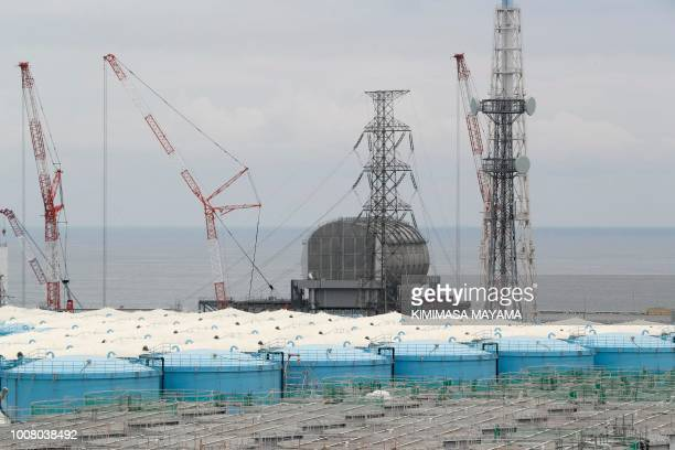 This picture taken on July 27 2018 and made available on July 30 2018 shows reactor unit 3 over storage tanks of radiationcontaminated water at the...