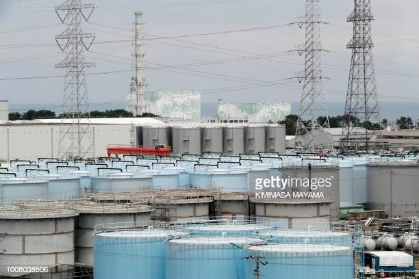 This picture taken on July 27 2018 and made available on July 30 2018 shows reactor unit 5 and 6 over storage tanks of radiation contaminated water...