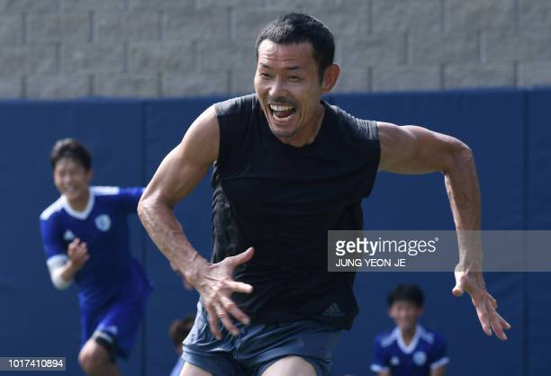 This picture taken on July 28 2018 shows Son Woongjung father of South Korean football star Son Heungmin on the pitch with his students at SON...