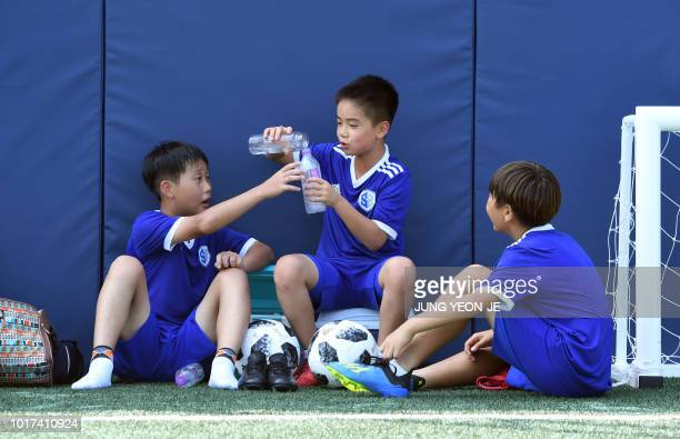 This picture taken on July 28 2018 shows young South Korean football students taking a rest at SON Football Academy in Chuncheon 75 kilometres east...