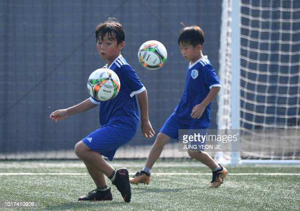 This picture taken on July 28 2018 shows young South Korean football students controlling the ball at SON Football Academy in Chuncheon 75 kilometres...