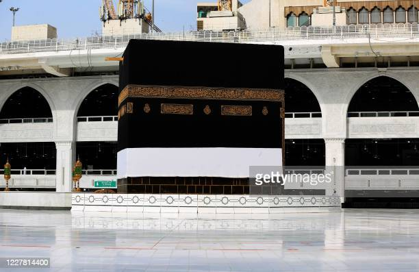 This picture taken on July 28 2020 shows a view of the Kaaba Islam's holiest shrine at the centre of the Grand Mosque in the holy city of Mecca ahead...