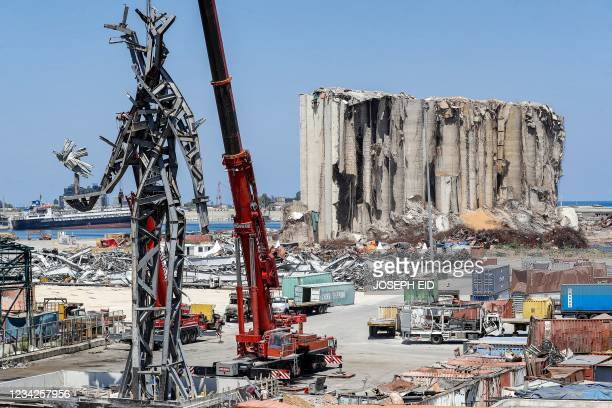 """This picture taken on July 28, 2021 shows a view of a 25-metre-tall steel sculpture dubbed """"The Gesture"""" by Lebanese artist Nadim Karam, made from..."""