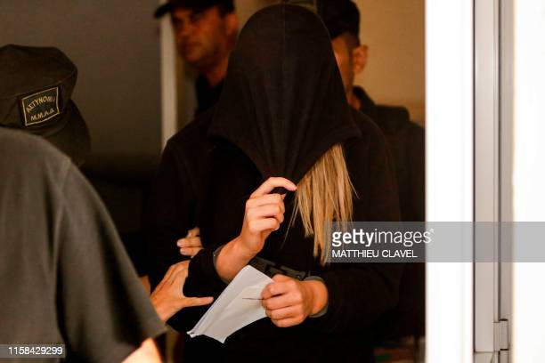 This picture taken on July 30 2019 shows a British teenager who accused seven Israelis of gang rape leaving the Famagusta District Court in Paralimni...