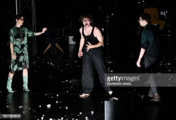 This picture taken on July 30, 2020 in Salzburg, Austria, shows actors Eva Loebau, Andre Kaczmarczyk and Christian Friedel during a dress rehearsal...