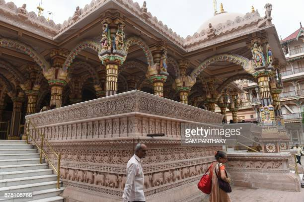 This picture taken on July 31 2017 shows Indian Hindu devotees at the nearly 200 years old Swaminarayan Kalupur Temple in Ahmedabad The crumbling...