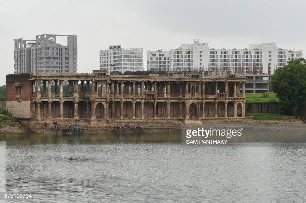 This picture taken on July 31 2017 shows the ruins of the 15th century 'Tombs of the Queens' building at the Sarkhej Roza complex in Ahmedabad The...
