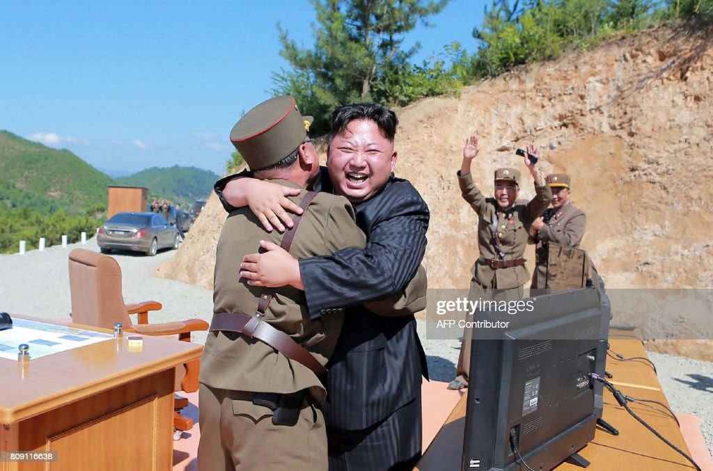 TOPSHOT - This picture taken on July 4, 2017 and released by North Korea's official Korean Central News Agency (KCNA) on July 5, 2017 shows North Korean leader Kim Jong-Un (C) celebrating the successful test-fire of the intercontinental ballistic missile Hwasong-14 at an undisclosed location. South Korea and the United States fired off missiles on July 5 simulating a precision strike against North Korea's leadership, in response to a landmark ICBM test described by Kim Jong-Un as a gift to 'American bastards'. / AFP PHOTO / KCNA VIA KNS / STR / South Korea OUT / REPUBLIC OF KOREA OUT ---EDITORS NOTE--- RESTRICTED TO EDITORIAL USE - MANDATORY CREDIT 'AFP PHOTO/KCNA VIA KNS' - NO