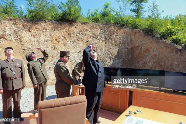 This picture taken on July 4 2017 and released by North Korea's official Korean Central News Agency on July 5 2017 shows North Korean leader Kim...