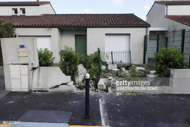 This picture taken on July 4 2018 in the Breil neighborhood of Nantes shows a wall damaged by the car driven by a man who was shot dead by an officer...