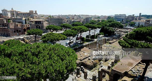 This picture taken on July 5 2013 shows a view of the Fori Imperiali leading to the Colosseum in Rome It was announced the same day that the Fori...
