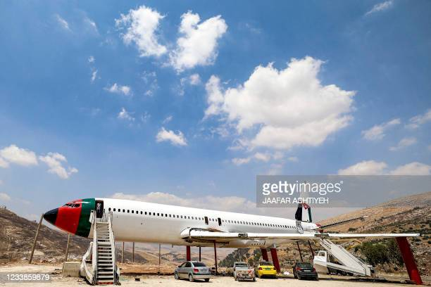 This picture taken on July 5, 2021 shows a view of the fuselage of a Boeing 707 aircraft being converted by Palestinian twin brothers Atallah and...