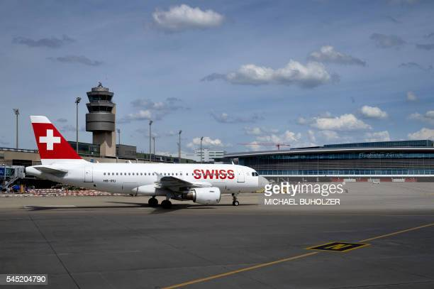 This picture taken on July 6 shows an Airbus A319 of the Swiss International Airlines taxiing on the tarmac at the Zurich Airport in Zurich / AFP /...