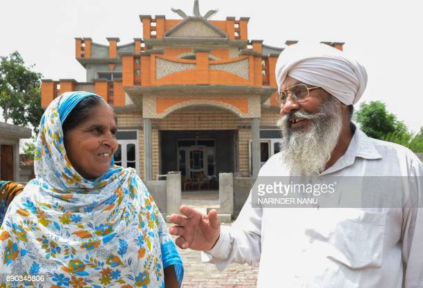 This picture taken on July 6 shows Narinder Kaur 54 along with her husband Gurmej Singh 60 talking at their residence in Kotladoom about 16 Km from...