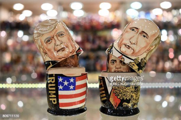This picture taken on July 6 shows traditional Russian wooden nesting dolls called Matryoshka dolls depicting US President Donald Trump and Russia's...