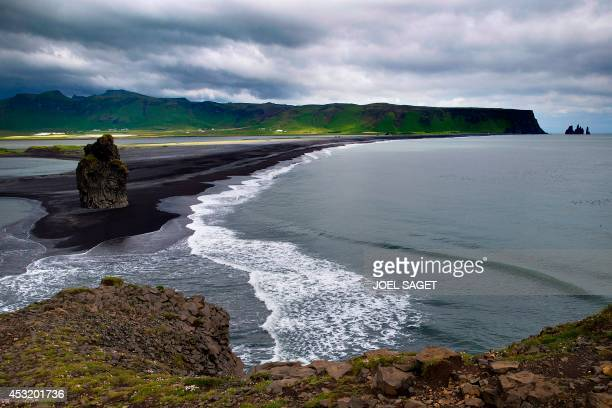 This picture taken on July 7 2014 shows a view of the Dyrholaey natural reserve near Vik in southern Iceland on July 7 2014 AFP PHOTO / JOEL SAGET