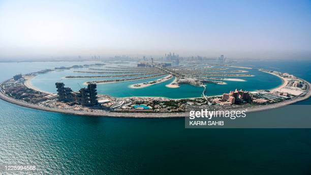 This picture taken on July 8, 2020 shows an aerial view of the Atlantis The Palm luxury hotel resort and the under-construction Royal Atlantis Resort...