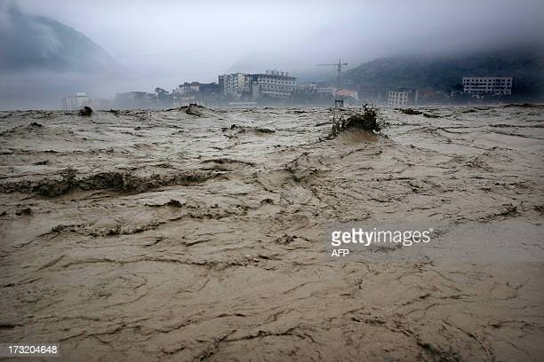 This picture taken on July 9, 2013 shows heavy flood waters sweeping through Beichuan in southwest China's Sichuan province. Rainstorms sweeping...